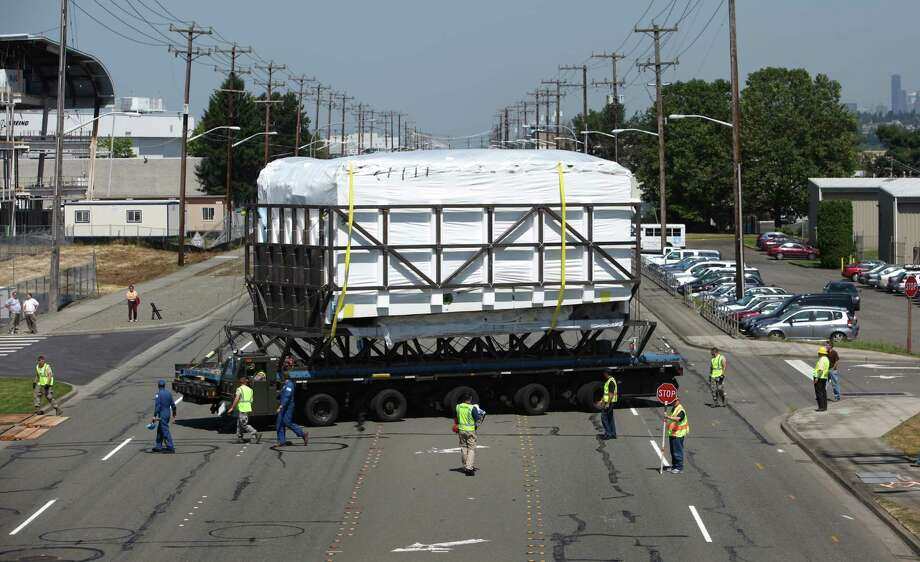 The aft section of the Space Shuttle Trainer payload bay is moved across East Marignal Way South to the Museum of Flight on Thursday, July 26, 2012. The crew cabin was delivered earlier to the museum aboard NASA's Super Guppy. The middle section of the Shuttle trainer is scheduled to be delivered on August 9th. Photo: JOSHUA TRUJILLO / SEATTLEPI.COM
