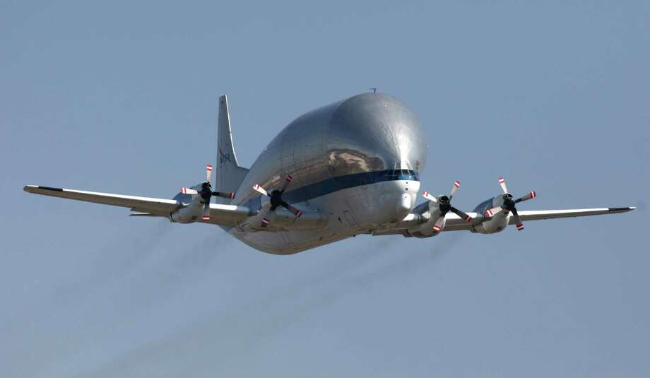 NASA's Super Guppy does a flyover at Boeing Field during a delivery of the aft section of the Space Shuttle Trainer payload bay to the Museum of Flight on Thursday, July 26, 2012. The crew cabin was delivered earlier to the museum. The middle section of the Shuttle trainer is scheduled to be delivered on August 9th. Photo: JOSHUA TRUJILLO / SEATTLEPI.COM