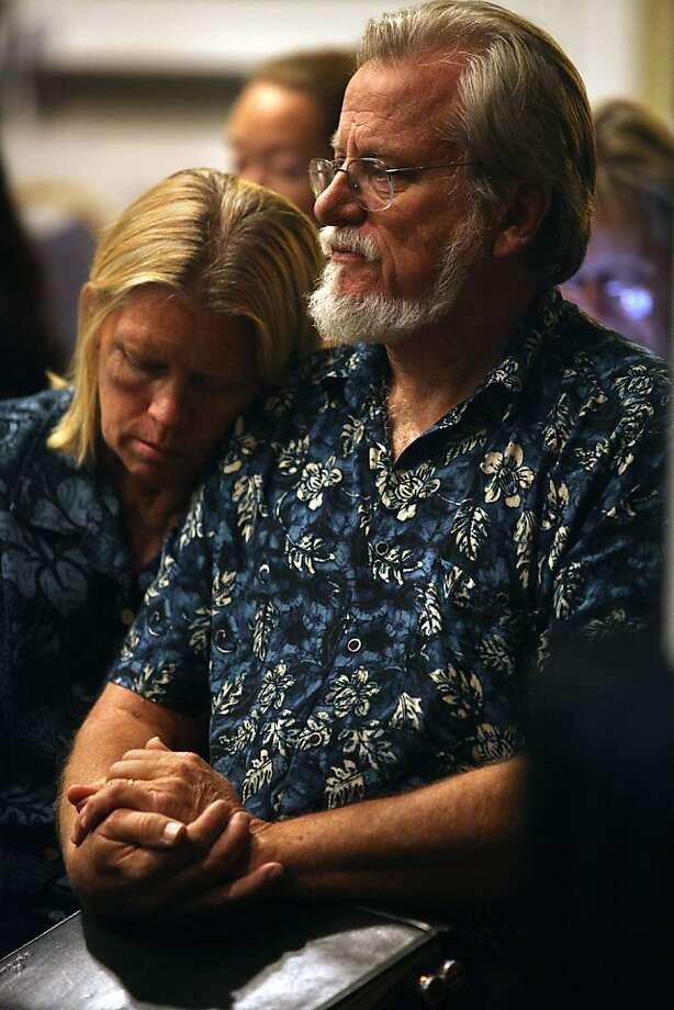 Carla and Ted Krull of Orange County listen as research grants are being approved in Burlingame. Their daughter suffers from Huntington's disease. Photo: Liz Hafalia, The Chronicle
