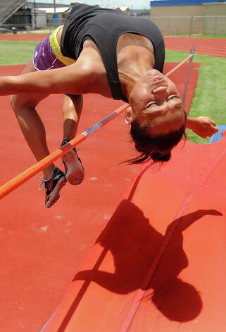 Alexus Henry, 14, practices the high jump on Wednesday. The Bridge City athlete will compete in the 2011 USATF Junior Olympic Track and Field Championships in late July.  Guiseppe Barranco/The Enterprise Photo: Guiseppe Barranco
