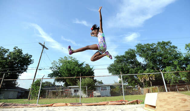 Kirsten Williams practices her long jump during the Port Arthur Track Club at the auxillary track in Port Arthur, Tuesday, July 3, 2012. Tammy McKinley/The Enterprise Photo: TAMMY MCKINLEY