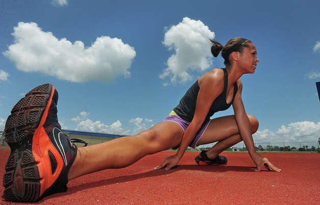 Alexus Henry, 14, stretches before practicing the high jump on Wednesday. The Bridge City athlete will compete in the 2011 USATF Junior Olympic Track and Field Championships in late July.  Guiseppe Barranco/The Enterprise Photo: Guiseppe Barranco