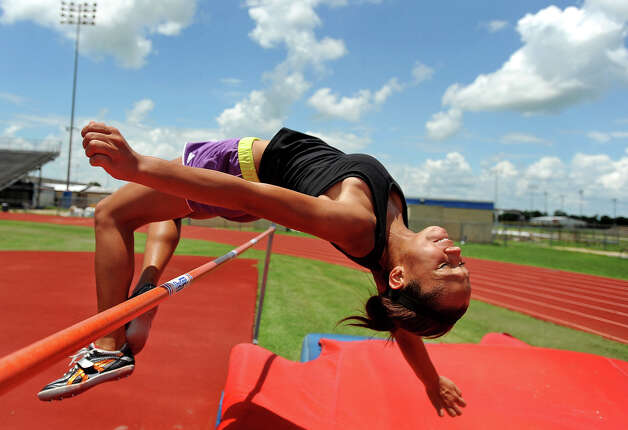 Alexus Henry, 14, practices the high jump on Wednesday. The Bridge City athlete will compete in the 2011 USATF Junior Olympic Track and Field Championships in late July.  Photo taken Wednesday, July 20, 2011. Guiseppe Barranco/The Enterprise Photo: Guiseppe Barranco