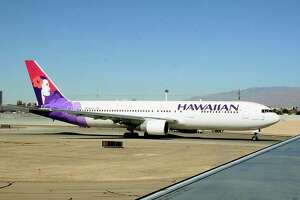 Washington, UNITED STATES:  A Hawaiian Airlines jet taxies out to the runway at Phoenix Sky Harbor International Airport in Phoenix, Arizona 14 February, 2006. AFP PHOTO/Karen BLEIER
