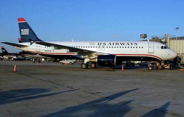 The merger of American Airlines and US Airways, announced Thursday, would make US Airways the latest in a long string of airline brands to disappear in this country. Photo: William Thomas Cain, Getty Images / 2005 Getty Images