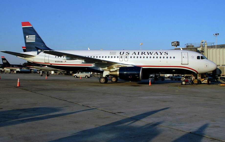 The merger of American Airlines and US Airways will mean the end of the US Airways brand. Photo: William Thomas Cain, Getty Images / 2005 Getty Images