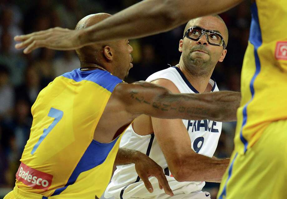 Tony Parker (right), who will wear protective goggles in the Olympics, is seeing things in a different light these days. Photo: Patrick Hertzog, AFP/Getty Images / AFP