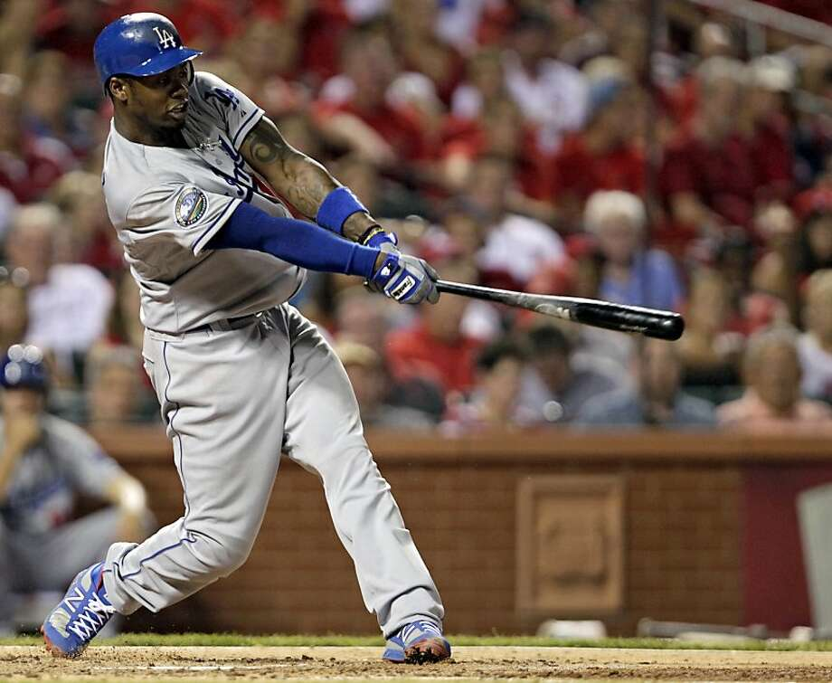 Los Angeles Dodgers' Hanley Ramirez follows through on his RBI single in the sixth inning of a baseball game against the St. Louis Cardinals, Wednesday, July 25, 2012, in St. Louis. (AP Photo/Tom Gannam) Photo: Tom Gannam, Associated Press