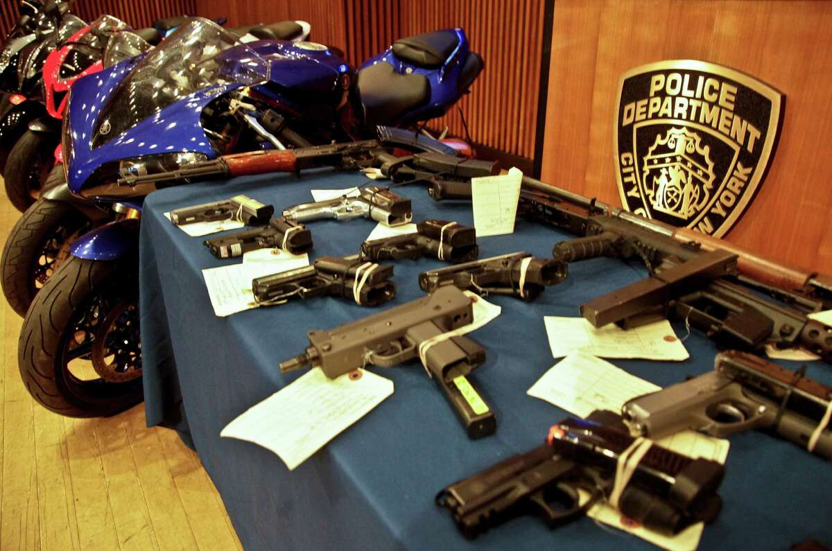 Stolen motorcycles and illegal firearms are displayed at a press conference where New York Police Department Commissioner Raymond Kelly and Manhattan District Attorney Cyrus Vance, Jr. announce the indictment of 33 defendants for stealing and selling motorcycles and illegal firearms, Thursday, July 26, 2012 in New York. (AP Photo/Bebeto Matthews)