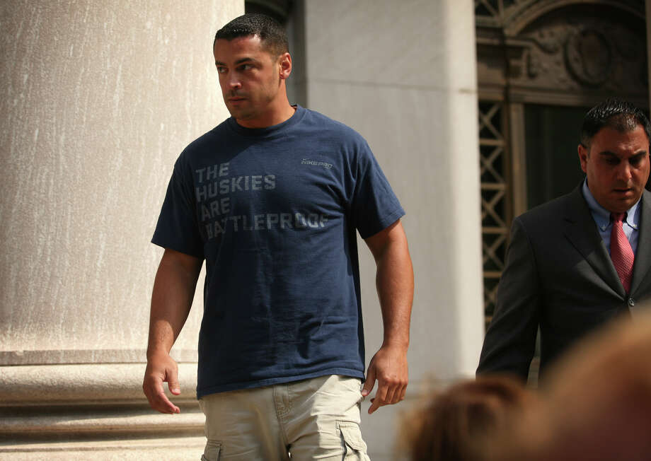 George Tirado, 35, of Waterbury, a co-owner of Smoke House Tobacco, leaves District Court on Church Street in downtown New Haven on Thursday, July 26, 2012. Tirado was arrested earlier in the day in the Christopher Donovan influence peddling case. Photo: Brian A. Pounds / Connecticut Post