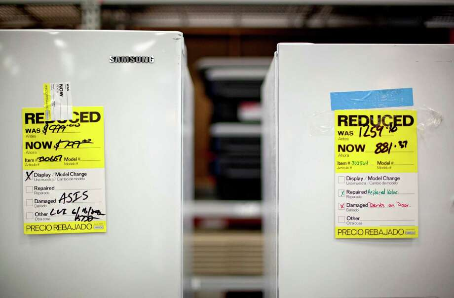 In this Tuesday, June 19, 2012 photo, price tags are seen on refrigerators on a showroom floor at Lowe's store in Atlanta. Companies cut back on orders for long-lasting U.S. factory goods last month, outside volatile aircraft and other transportation equipment. The decline suggests businesses are losing confidence in the economy. Orders for durable goods rose a seasonally adjusted 1.6 percent in June from May, the Commerce Department said Thursday, July 26, 2012. (AP Photo/David Goldman) Photo: David Goldman
