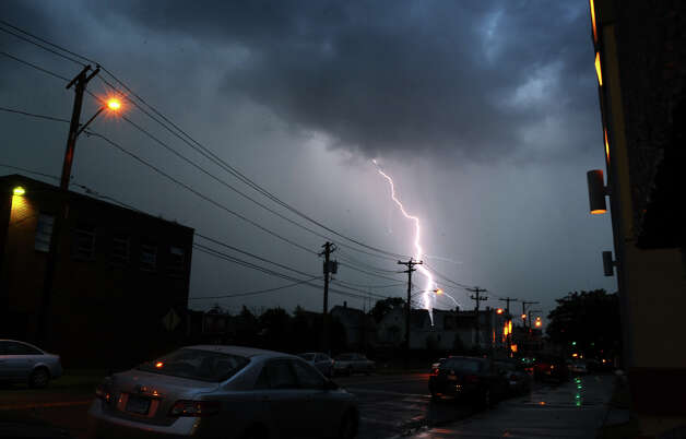 A lightning bolt strikes on the east end of Bridgeport looking towards Connecticut Avenue from Union Avenue in Bridgeport, Conn. on Thursday July 26, 2012. Photo: Christian Abraham / Connecticut Post
