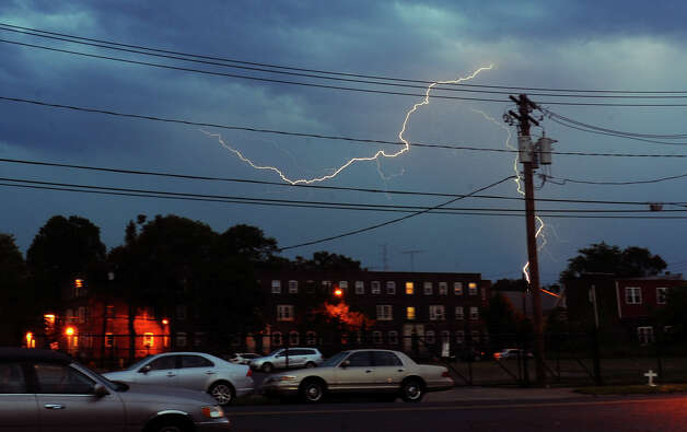 A lightning bolt strikes on the east end of Bridgeport from Union Avenue in Bridgeport, Conn. on Thursday July 26, 2012. Photo: Christian Abraham / Connecticut Post