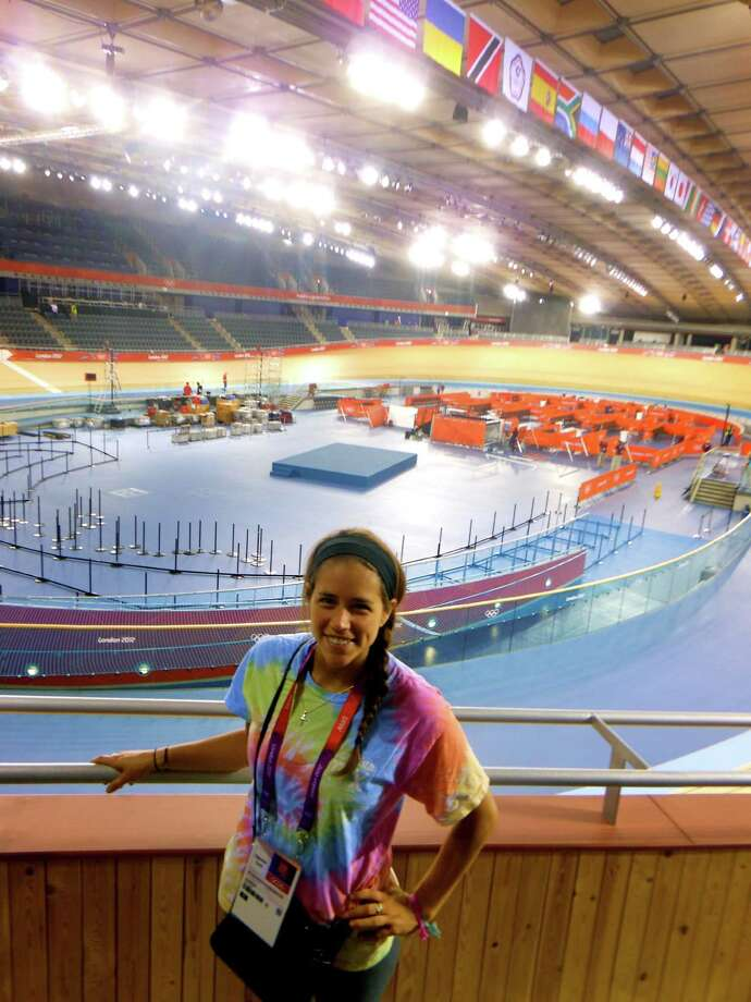 Stamford native Emily Powers, who is interning for NBC at the Olympics in London, poses at the velodrome where the cycling events will take place. Photo: Contributed Photo