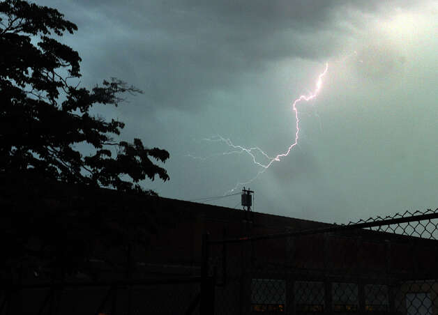 A view os a lightning bolt strike on the east end of Bridgeport on Union Avenue in Bridgeport, Conn. on Thursday July 26, 2012. Photo: Christian Abraham / Connecticut Post