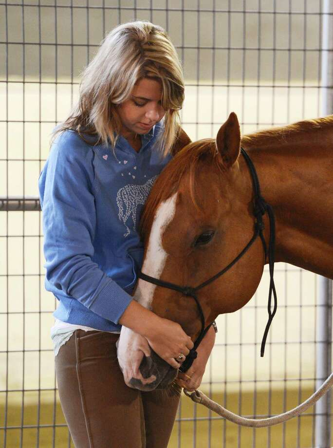 Military suicide widow Rebecca Morrison, has a quiet moment with Butter during her introduction to the Saratoga War Horse Program in Saratoga Springs, N.Y. July 26, 2012    (Skip Dickstein/Times Union) Photo: Skip Dickstein