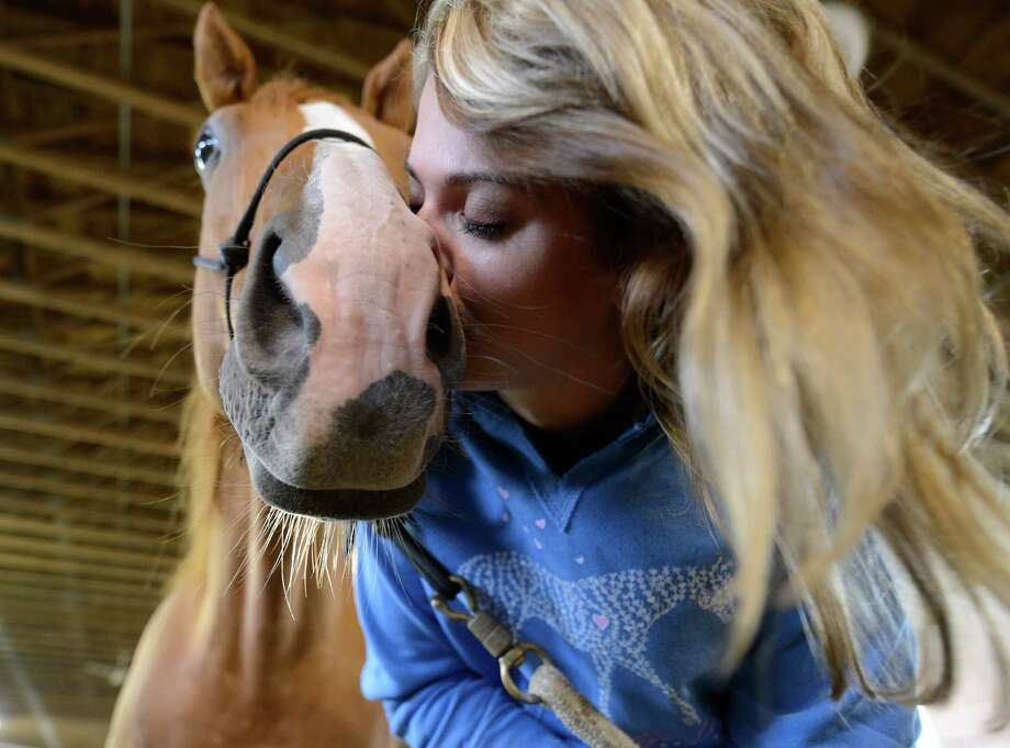 Military suicide widow Rebecca Morrison, gives Butter a kiss on the nose during her introduction to the Saratoga War Horse Program in Saratoga Springs, N.Y. July 26, 2012    (Skip Dickstein/Times Union) Photo: Skip Dickstein