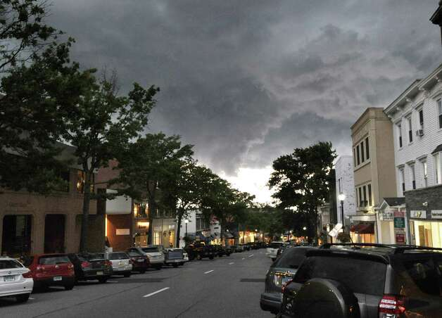 Greenwich Avenue covered by a blanket of dark clouds during the storm that passed through the area Thursday night, July 26, 2012. Photo: Bob Luckey / Greenwich Time