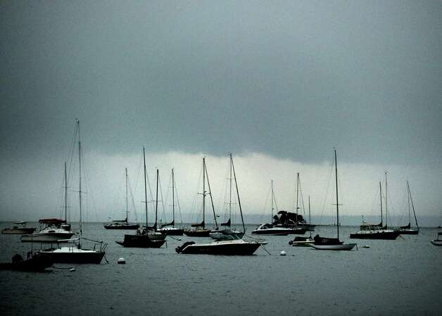 Dark clouds over Greenwich Harbor during the storm that passed through the area Thursday night, July 26, 2012. Photo: Bob Luckey / Greenwich Time