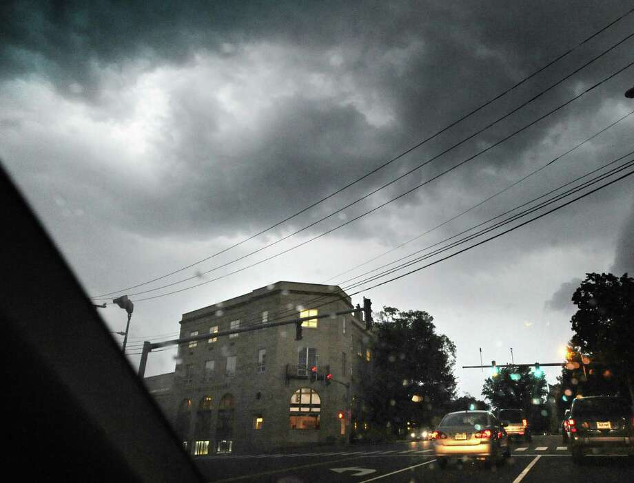 Dark clouds over Greenwich Library during the storm that passed through the area Thursday night, July 26, 2012. Photo: Bob Luckey / Greenwich Time