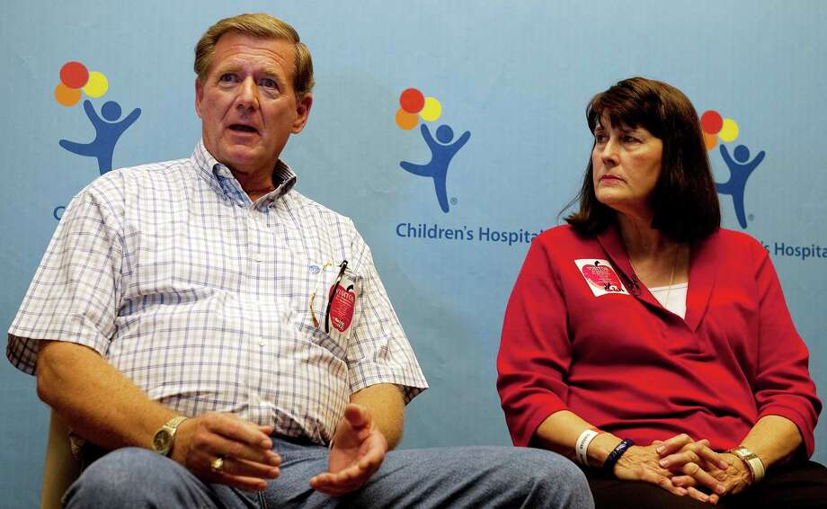 "Larry Lowak, left, and Sue Greene, parents of Brent Lowak, speaks at the Children's Hospital Colorado, in Aurora, Colo., where their son is recovering from bullet wounds, Sunday, July 22, 2012 in Aurora, Colo. Brent Lowak, 27, is one of six victims of the shootings at  the Century Aurora 16 Cineplex being treated at the Children's Hospital Colorado. 12 people were killed and 58 were wounded early Friday morning while attending the opening of ""The Dark Knight Rises."" The suspected gunman was arrested at the scene shortly after the shootings. Brent was attending the film with close friend Jessica Ghawi, who was killed in the attack. (AP Photo/The Denver Post, Zach Ornitz) TV, INTERNET AND MAGAZINES CALL FOR RATES AND TERMS Photo: AP"