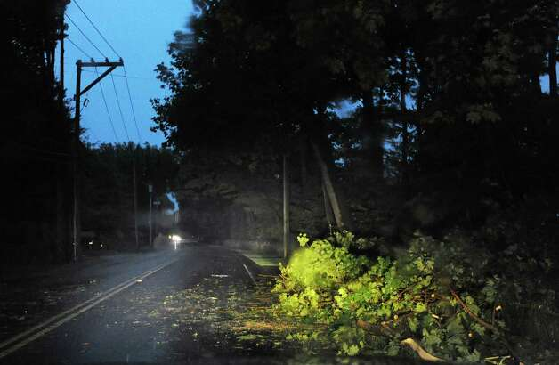 Downed tree limbs on upper North Street during the storm that passed through the Greenwich area Thursday night, July 26, 2012. Photo: Bob Luckey / Greenwich Time