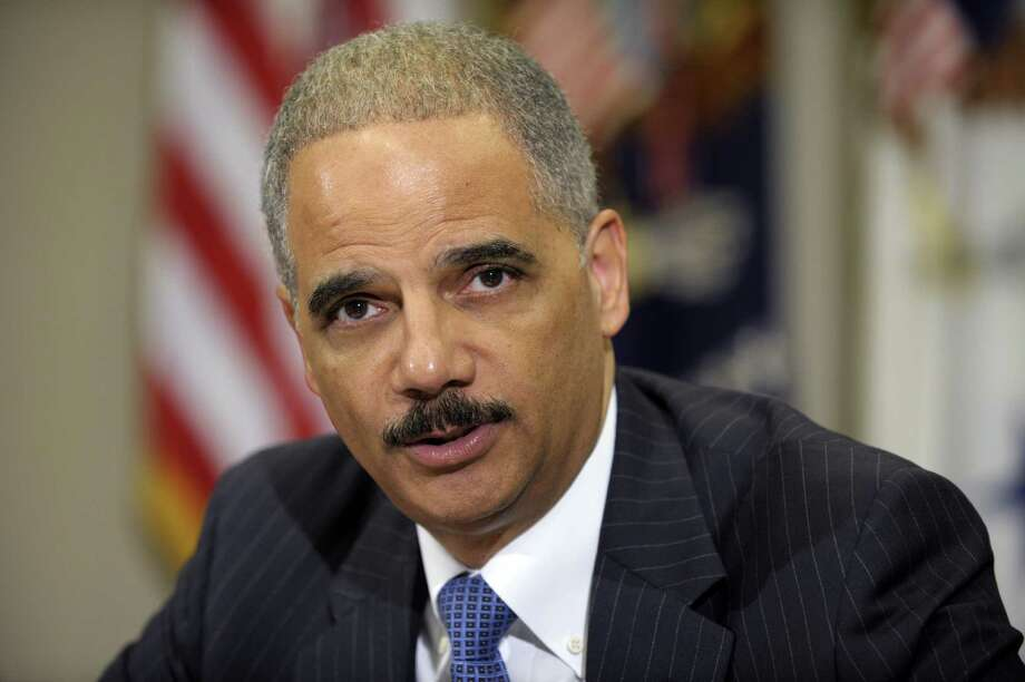 Attorney General Eric Holder speaks in the Cabinet Room of the White House in Washington, Thursday, July 26, 2012, where he announced the formation of a public-private partnership to fight fraud in the health care system. (AP Photo/Susan Walsh) Photo: Susan Walsh / AP