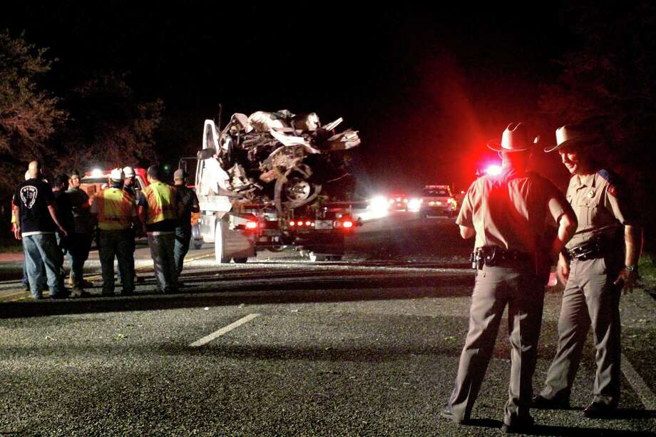 The mangled pickup that crashed near Goliad is hauled from the scene Sunday evening. Authorities said it was packed with illegal immigrants, 15 of whom died. Photo: Angeli Wright / VICTORIA ADVOCATE