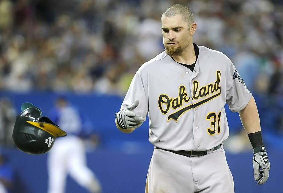 TORONTO, CANADA - JULY 26:  Jonny Gomes #31 of the Oakland Athletics tosses his helmet after striking out during MLB game action against the Toronto Blue Jays July 26, 2012 at Rogers Centre in Toronto, Ontario, Canada. (Photo by Brad White/Getty Images) Photo: Brad White, Getty Images