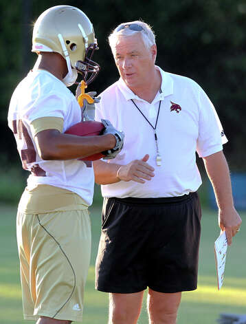 Texas State coach Dennis Franchione gives a receiver some advice on passing routes during a practice session. Photo: TOM REEL, SAN ANTONIO EXPRESS-NEWS / © 2011 San Antonio Express-News