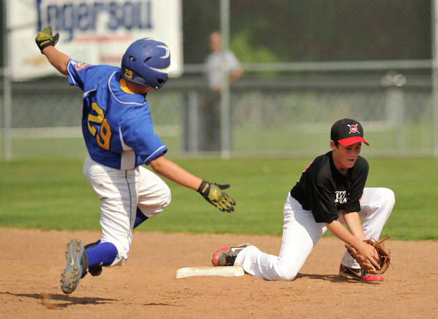 Newtown's Ben Dieckman is forced out at second base by New Canaan shortstop Dillon Abate during their Cal Ripken 12-year-olds New England tournament final at Glander Field in Newtown on Thursday, July 26, 2012. New Canaan won 9-8 in 11 innings. Photo: Jason Rearick / The News-Times