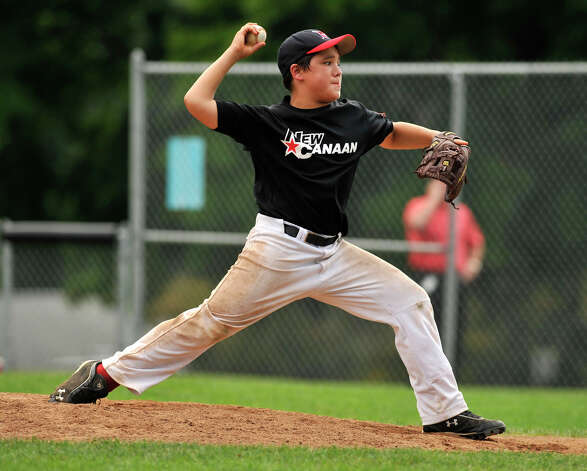 New Canaan's Mike Pelli pitches during their Cal Ripken 12-year-olds New England tournament final against Newtown at Glander Field in Newtown on Thursday, July 26, 2012. New Canaan won 9-8 in 11 innings. Photo: Jason Rearick / The News-Times