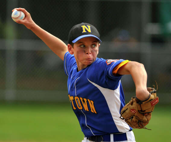 Newtown's Ryan Kost pitches during their Cal Ripken 12-year-olds New England tournament final against New Canaan at Glander Field in Newtown on Thursday, July 26, 2012. New Canaan won 9-8 in 11 innings. Photo: Jason Rearick / The News-Times