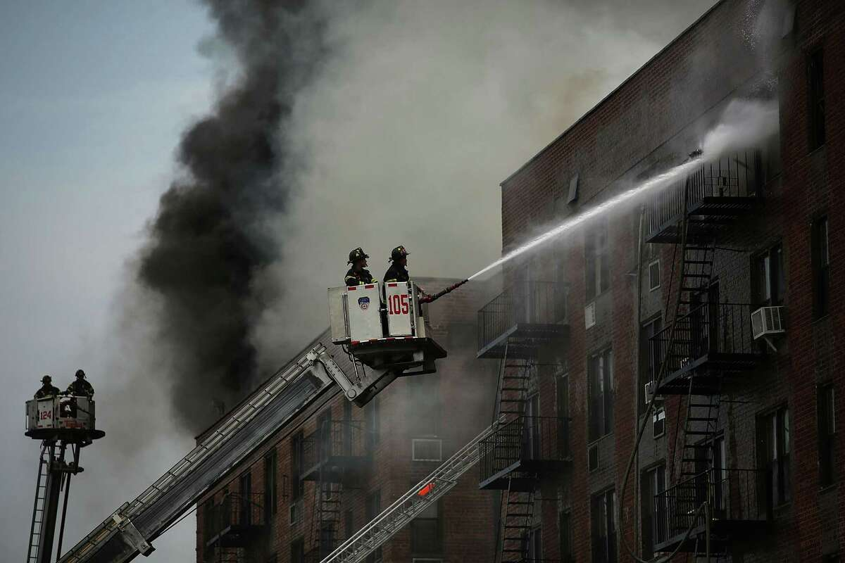 *** BESTPIX *** NEW YORK, NY - JULY 26: Firefighters battle a six-alarm fire at a seven-story apartment building in the Prospect Lefferts Gardens of Brooklyn on July 26, 2012 in New York City. Fire officials have reported 14 injuries among residents and firefighters at the building, which houses 115 residential units. (Photo by Spencer Platt/Getty Images)