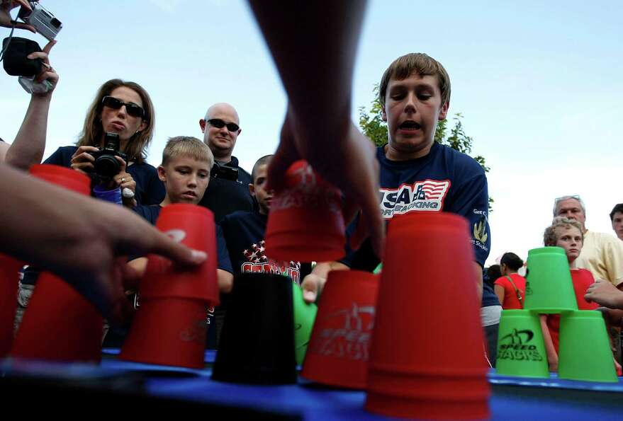 Junior Olympic cup stacking contestants Dominic Valerian, 14, right, of Cleveland, Ohio and William