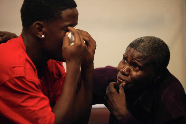 Eugene Hodge, 16, left, the youngest brother of Antwan Wolford, is comforted by their grandmother, Helen Ward, right, after Tiffany James was found guilty of manslaughter for the death of Wolford in the Bexar County 399th District Court on Thursday, July 26, 2012. Photo: Lisa Krantz, San Antonio Express-News / San Antonio Express-News