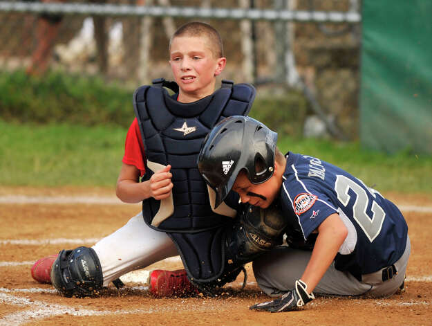 Oxford's Joey Yacovelli is tagged out at home by New Fairfield catcher Ryan Grimaldi during their Cal Ripken 11-year-old state tournament final at Tegmier Field in New Fairfield on Thursday, July 26, 2012. Photo: Jason Rearick / The News-Times