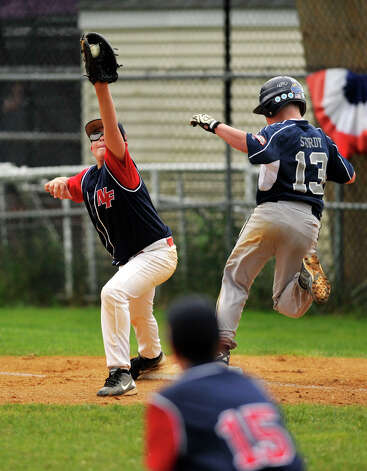 Oxford's Matt Stordy beats the throw to first base as New Fairfield's Robert Zurzola makes the catch during their Cal Ripken 11-year-old state tournament final at Tegmier Field in New Fairfield on Thursday, July 26, 2012. Photo: Jason Rearick / The News-Times