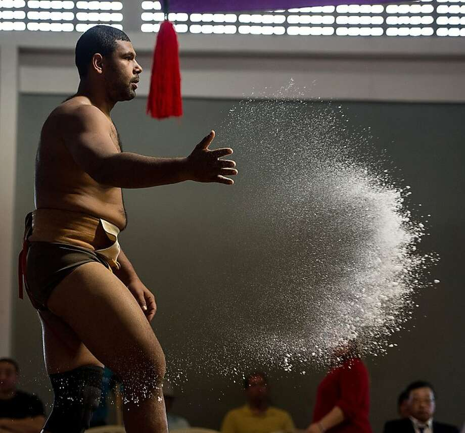 Cassio Gomes of Brazil throws a handful of salt into the ring during the Sumo wrestling South American Championship in Sao Paulo, Brazil, on July 22, 2012. AFP PHOTO/Yasuyoshi CHIBAYASUYOSHI CHIBA/AFP/GettyImages Photo: Yasuyoshi Chiba, AFP/Getty Images
