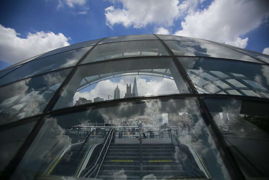 Cloud in the sky is reflected in a glass dome Thursday, July 26, 2012 in Shanghai, China. (AP Photo/Eugene Hoshiko) Photo: Eugene Hoshiko, Associated Press