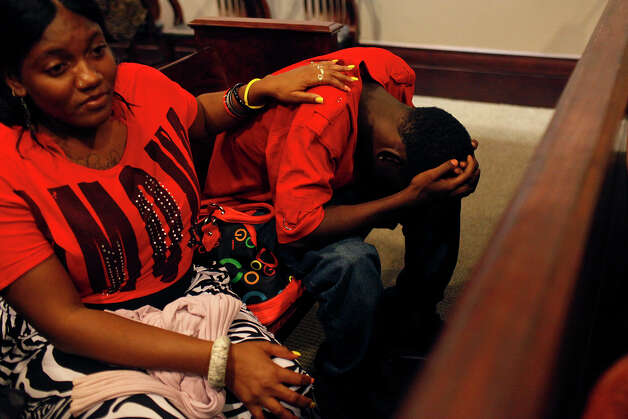 Destiny Terry comforts her nephew, Eugene Hodge, 16, the youngest brother of Antwan Wolford, after Tiffany James was found guilty of manslaughter for the death of Wolford in the Bexar County 399th District Court on Thursday, July 26, 2012. Photo: Lisa Krantz, San Antonio Express-News / San Antonio Express-News