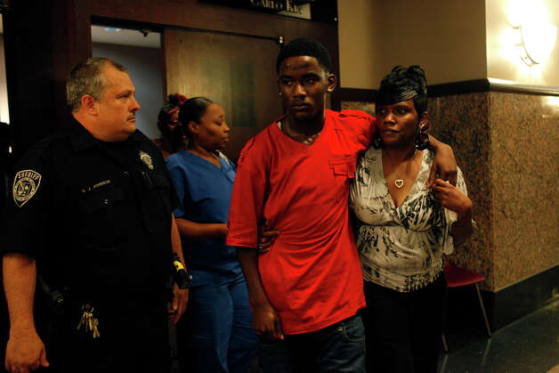 Eashonne Wolford, right, the mother of Antwan Wolford, leaves the courtroom with her youngest son, Eugene Hodge, 16, after Tiffany James was found guilty of manslaughter for the death of Wolford in the Bexar County 399th District Court on Thursday, July 26, 2012. Photo: Lisa Krantz, San Antonio Express-News / San Antonio Express-News