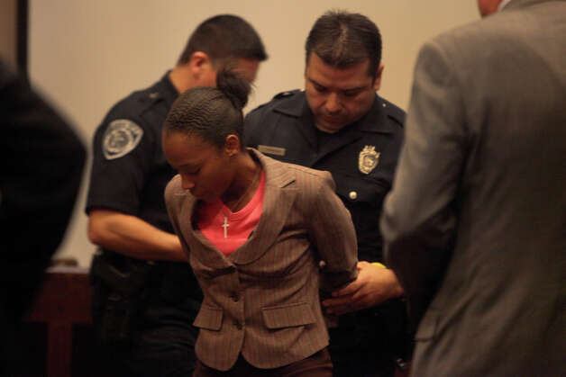 Tiffany James is taken into custody after she was found guilty of manslaughter for the death of Antwan Wolford in the Bexar County 399th District Court on Thursday, July 26, 2012. Photo: Lisa Krantz, San Antonio Express-News / San Antonio Express-News