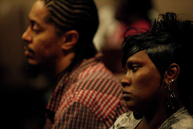 Eashonne Wolford, the mother of Antwan Wolford, cries as she sits in the front row with her husband, Dawayne Huggins, during closing arguments for Tiffany James' murder trial for the death of Wolford in the Bexar County 399th District Court on Thursday, July 26, 2012. Photo: Lisa Krantz, San Antonio Express-News / San Antonio Express-News