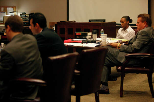 Tiffany James, right, watches the prosecution, left, as she sits with defense attorney Bill Reece, far right, during her murder trial for the death of Antwan Wolford in the Bexar County 399th District Court in San Antonio on Wednesday, July 25, 2012. Photo: Lisa Krantz, San Antonio Express-News / San Antonio Express-News