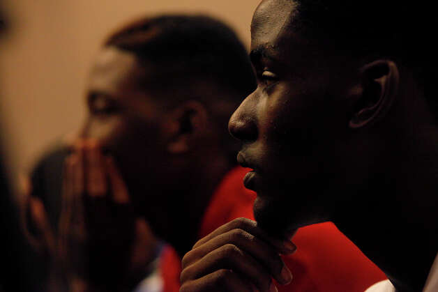 Eugene Hodge, 16, right, and his brother, Sedrick Wolford, 17, left, watch the proceedings in the trial of Tiffany James, who is charged with the murder of their older brother, Antwan Wolford, in the Bexar County 399th District Court in San Antonio on Wednesday, July 25, 2012. Photo: Lisa Krantz, San Antonio Express-News / San Antonio Express-News