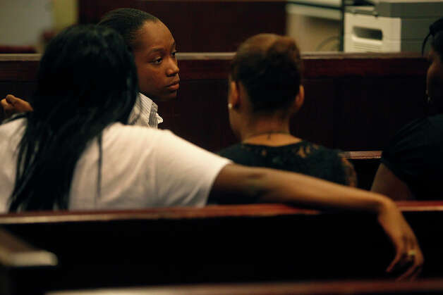 Tiffany James talks with supporters during a break in her murder trial for the death of Antwan Wolford in the Bexar County 399th District Court in San Antonio on Wednesday, July 25, 2012. Photo: Lisa Krantz, San Antonio Express-News / San Antonio Express-News