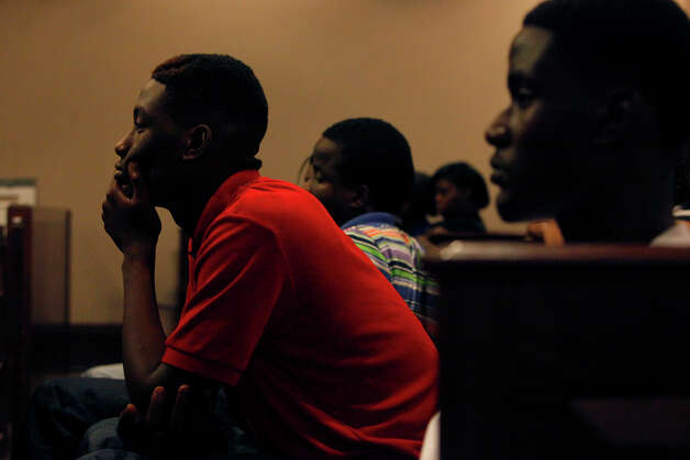 The brothers of victim Antwan Wolford, including Sedrick Wolford, 17, from left, Charles Wolford, 19 and Eugene Hodge, 16, watch the proceedings in the trial of Tiffany James, who is charged with the murder of Wolford, in the Bexar County 399th District Court in San Antonio on Wednesday, July 25, 2012. Photo: Lisa Krantz, San Antonio Express-News / San Antonio Express-News