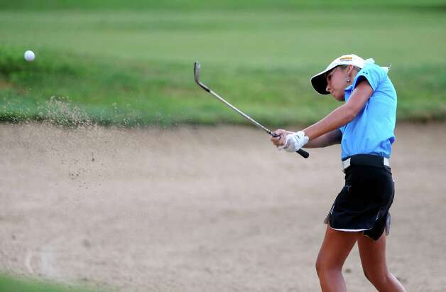 Caitlin Brown hits out of a bunker on the No. 10 hole during first-round action of the Greater San Antonio Junior Championship at Brackenridge Park Golf Course on Tuesday, July 24, 2012. Photo: Billy Calzada, San Antonio Express-News / © 2012 San Antonio Express-News