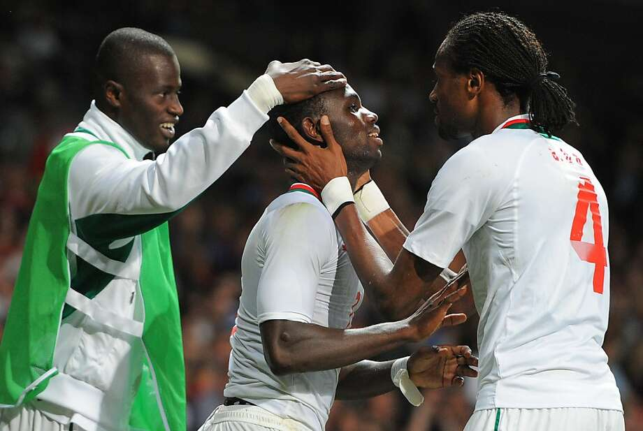 Senegal's Moussa Konate (C) celebrates after scoring during the London 2012 Olympic Games men's football match between Britain and Senegal at Old Trafford in Manchester, north-west England on July 26, 2012. AFP PHOTO / ANDREW YATESANDREW YATES/AFP/GettyImages Photo: Andrew Yates, AFP/Getty Images